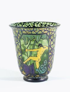 Marcel Goupy A VASE thickly enamelled with three panels enclosing a naked archer and deer on a gilt heightened ground painted mark, `M Goupy' 16.5cm.; 6 1/2 in. circa 1925