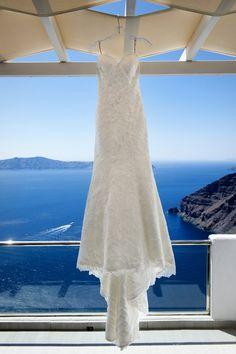white wedding dress blue sky santorini greece