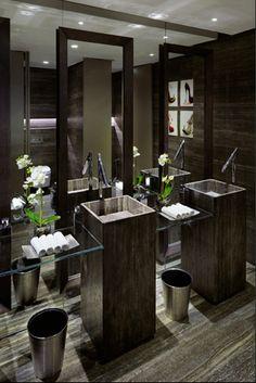 Floor to ceiling mirror behind sink