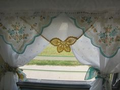 Hankie curtains.. just the valance. something like this.