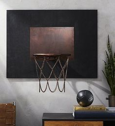 Hoop dreams. Handmade, hand-polished and fashion-inspired. Designed by Barcelona-based design studio Mermelada Estudio, navy leather backboard with beautifully patinaed rim and chain doubles as a functioning basketball hoop and wall-mounted decor. Plays perfectly in a home office, den or man cave with our Modest Vintage Player Heritage Navy Leather Activity Ball. Learn about Mermelada Estudio on our blog.