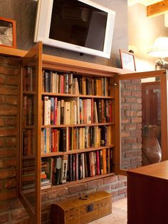 A Repurposed Fireplace. Pin if you like the idea :) #books #fireplace #design