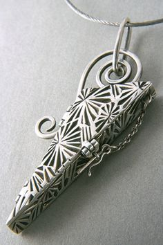"""Triangle Box"" - locket by Terry Kovalcik.  Silver precious metal clay (PMC+, PMC+ sheet, PMC3 paste .999), SS cable, wire & chain."