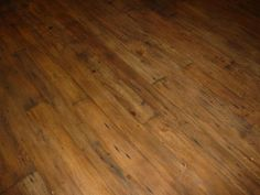 Love the look of reclaimed wood floor…especially with a few modern touches mixed in.