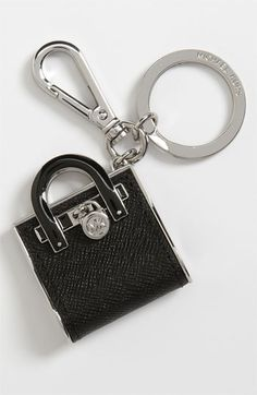 I just bought this. It's SO CUTE. I hang it off my Michael Kors Hamilton tote (the real version of the keychain)