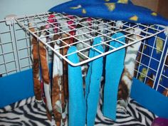 A clever idea if you have a shy little furry friend: fleece strips tied to top of cage- handy if you rabbit or guinea pig runs and hides behind things Pet Guinea Pigs, Guinea Pig Care, Diy Guinea Pig Toys, Rat Cage, Rat Toys, Guinea Pig Bedding, Fancy Rat, Bunny Care, Pet Rats