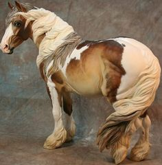 This is a traditional Scarlett. The mane, tail and forelock were customized by Stacey Tumlinson. Her feathers and painting were done by Paloose Art.