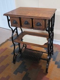 The cast-iron handles are lady's faces. The original table was in extremely bad shape and only had 3-drawers. I used the machine-bed shelf with a mirror for the shelf. It turned out very nice.