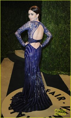 Lily Collins - Vanity Fair Oscars Party 2013 The 23-year-old The Mortal Instruments actress rocked a Zuhair Murad dress and Takat earrings to the star studded soiree.