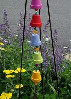 A colorful garden chime made with terra cotta pots