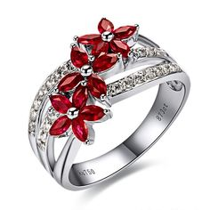 gorgeous red colour! Love the style. Bold without using huge gems. Maybe too different to be an engagement ring forever?