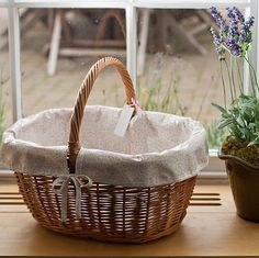 Now available here: http://www.lucylilybet.co.uk/kitchen_baskets.html  Beautiful oilcloth lined wicker basket =)