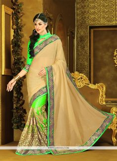 Get going with this majestic and wonderful piece and make your dream attire look richer to your persona. Look ethnic in this affluent green jacquard designer saree. Beautified with embroidered and pat...
