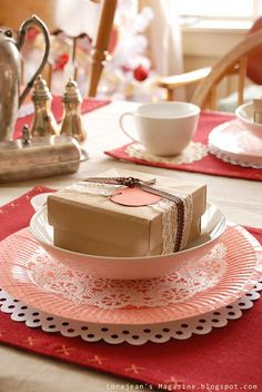 Tablescape using paper doilies + wrapped gift.