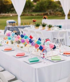 For an easy and affordable tablescape, DIY colorful oragami paper structures.