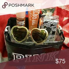 Victoria Secret Pink goodie bag This is nwt Vs pink black cooler that is loaded with heart pink sunglasses, a waterproof camera that says pink all over it, chill out pink shower gel and lotion and spray is sun-kissed. Victoria's Secret Other