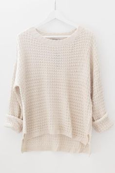 Classic chunky knit sweater with a round neckline and open knitted material. Makes a perfect pullover sweater paired with a lace bralette or crop top underneath