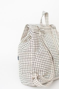 Baggu Drawstring backpack in natural grid. A simple canvas satchel for  daily essentials. Roomy 3094963fbfcae