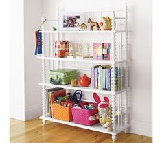 I'm sort of in love with Jenny Lind cribs right now - and this is an adorable matching bookshelf!