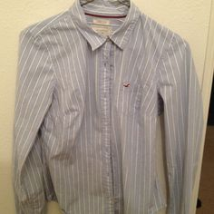 Collard shirt Long sleeve blue shirt with red and white pinstripes. This women's dress shirt is fitted and super cute with skinny jeans. Hollister Tops