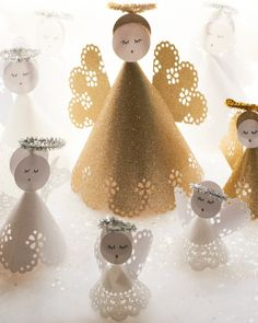Paper angels made of glitter paper, doilies, and pipe cleaners are an affordable DIY decoration for centerpieces, mantle decor, or cake toppers. Draw your own faces (especially fun for kids) or print these templates on circle labels.