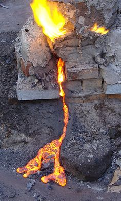 Slag escaping from a furnace during the smelting of iron ore.