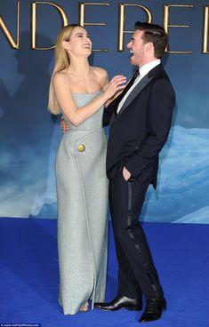 The good times never end: Lily was joined by her co-star Richard Madden who plays Prince Charming in the movie