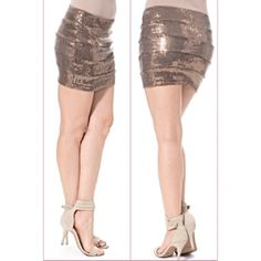 Mocha Sequin Mini Skirt Perfect for NYE16!!! Get them now as I only have limited quantities! This beautiful mocha colored sequin skirt features a super soft skirt with beautiful sparkly mocha/dark gold sequins. The spandex waist band is perfectly stretchy so it won't dig in. Have S M L. S fits 2-4 M fits 6-8 L fits 10-12. Hot! Price is firm unless bundled. Don't wait last minute to get your NYE outfit. Get it here quick! Fits a tad snug like a bodycon. Consider a size up if you want a more…