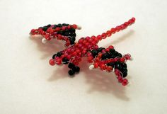my first beaded dragon inspirated by this tutorial used: sead beads, stainless steal wire edit: along this one i did two another, better i guess