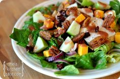 Romaine Salad with Chicken, Cheddar, Apples, Spiced Pecans, and Cranberry Vinaigrette