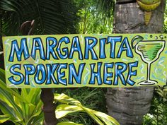 Margarita Spoken Here Tropical Tiki Bar Beach House Sign. $25.00, via Etsy.