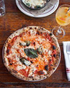 margherita pizzas topped with tomato, mozzarella, grana, and basil.