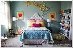 What a great kids room. The bookshelves are genius.