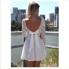 """White lace skater dress open back Fun skater style dress with lace upper Long sleeves for the winter Low V back with bow detail Invisable side zipper opening.  US Size XS (2). Bust: 30.5"""" Waist: 24.5"""" Hips: 33.5"""". AU size 6. Dresses"""