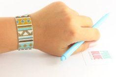 """************************** 100% Handmade *******************************    Mori"" Bracelet | Bead Loom Bracelet with Miyuki Delica Seed Beads | Bracelets For Women | Woven Adjustable Bracelet (Model: Mr016)    This bracelet is Made with high quality 11/0 Miyuki delica beads on nylon thread.    - Adjustable through an extension chain.    Length bracelet: approx. 16-21 cm (with extension chain)  Width bracelet: approx. 2.4 cm…"
