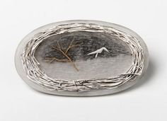Judy McCaig- 'Swirling Winds ' – brooch, silver, perspex, paint- 2010