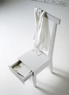 Wooden chair with hidden storage. Keep the clutter to a minimum finding storage space wherever you can.