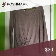FP Long Sleeve Taupe Knit Tee Worn a few times but still good condition! I tie it in the front as seen in the picture but doesn't have to be worn that way Free People Tops Tees - Long Sleeve