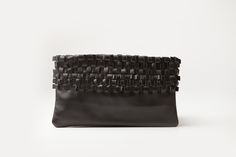 The 'Carla' - our gorgeous clutch range. This is the hand held black leather clutch with woven/pleated detail.