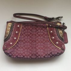 """SALE Coach wristlet Monogrammed with suede, leather, and stud accents. Inside includes a small pocket (can fit an iPhone). Has never been used, comes from a smoke free and pet free home! Still has the brand new """"Coach"""" smell! Coach Bags Clutches & Wristlets"""