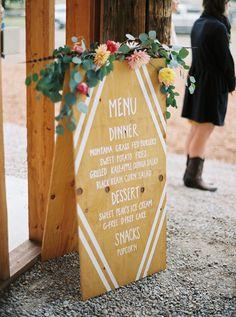 wooden menu sign - photo by Jeremiah and Rachel Photography http://ruffledblog.com/bohemian-montana-wedding