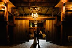 Couple's first dance under the wagon wheel chandelier at the Polo Barn. Sydney Polo Club Winter Wedding. Photography: Sutoritera