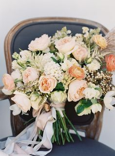 Ivory and peach bridal bouquet by Twigss Floral Studio. Photo by Rylee Hitchner Photography