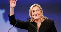 Marine Le Pen, France's National Front political party leader, waves as she attends the far-right party's congress in Lyon November 29, 2014