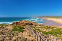 Praia da Amoreira – Aljezur, Algarve, Portugal is one of 8 lesser-known surfing spots around the world - via Lonely Planet 17-01-2018 | The unique beach is perfect for swimming, kayaking and surfing, and although it has fairly consistent waves, it's rarely crowded, even in the best conditions. Praia da Amoreira features a beach break with left and right hand waves, as well as two point breaks that peel into the middle of the bay from the cliffs on both sides.