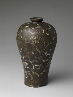 Stoneware vase, iron-brown and white-slip decoration of chrysanthemums under celadon glaze. Maebyeong Period: Goryeo dynasty, late 12th–early 13th C. Korea.