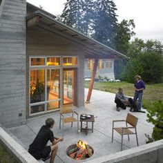 Roof line, windows, fireplace stone - and casual hangout firepit for everyday living.  That's what I like.