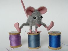 Felted mouse playing leapfrog on antique wooden spools by FeltSpecial, €115.00