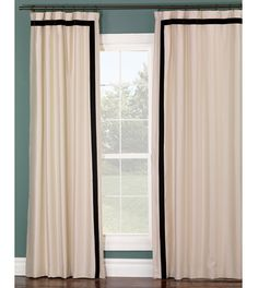ivory curtain panel with black stripe border