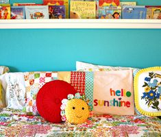 Love the bright blue, book ledge and happiness this room has. :)